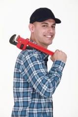 Plumbing team member with pipe wrench